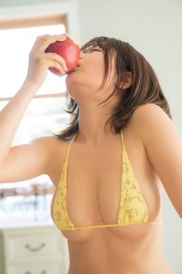 Momo Fujita bites into an apple while wearing a swimsuit003
