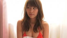 Ikumi Hisamatsu lounging on a bed in a red bikini Red swimsuit013