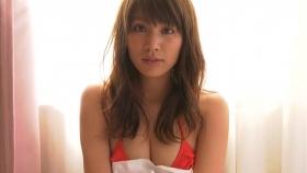 Ikumi Hisamatsu lounging on a bed in a red bikini Red swimsuit012