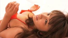 Ikumi Hisamatsu lounging on a bed in a red bikini Red swimsuit020