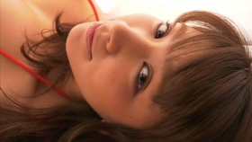 Ikumi Hisamatsu lounging on a bed in a red bikini Red swimsuit022